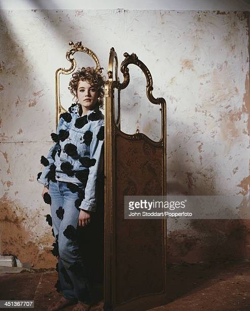 English actress Emily Lloyd leaning against a screen partition circa 1993