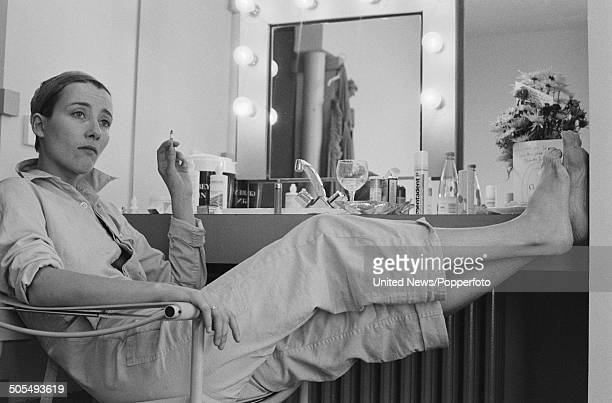 English actress Emma Thompson posed smoking a cigarette in a dressing room in London on 6th June 1984