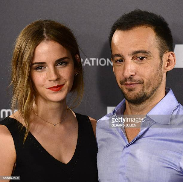 English actress Emma Watson and HispanoChilean film director Alejandro Amenabar pose during the photocall of their last film Regression in Madrid on...