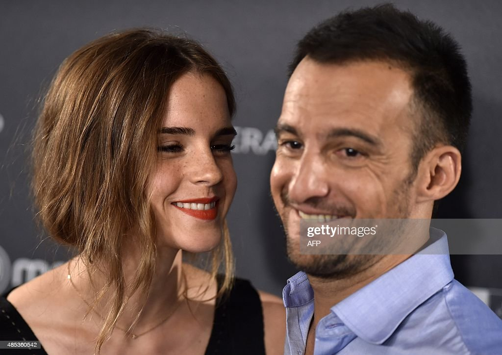 English actress Emma Watson (L) and Hispano-Chilean film director Alejandro Amenabar pose during the photocall of their last film 'Regression' in Madrid on August 27, 2015.