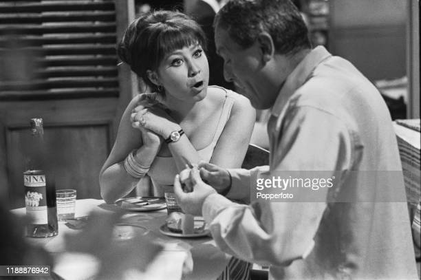 English actress Felicity Kendal playing the role of Jenny seated with actor Charles Gray during the shooting of a scene from the Associated...