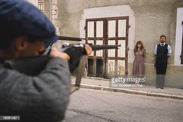 English actress Felicity Montagu as Nicole Dissard faces a firing squad in the British TV drama series 'Wish Me Luck' 1990