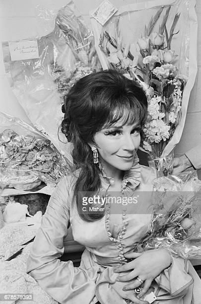 English actress Fenella Fielding surrounded by bouquets of flowers UK 2nd June 1966