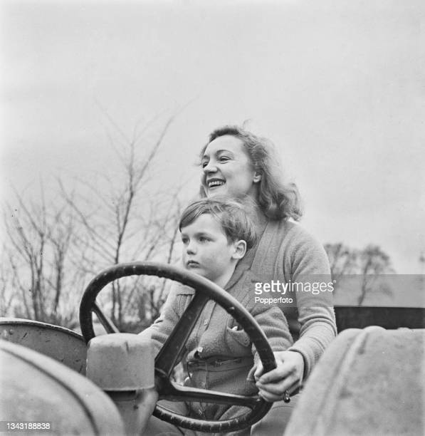 English actress Florence Desmond and her son Michael drive a tractor on her Pollards Cross farm at Hempstead near Saffron Walden in Essex, England...