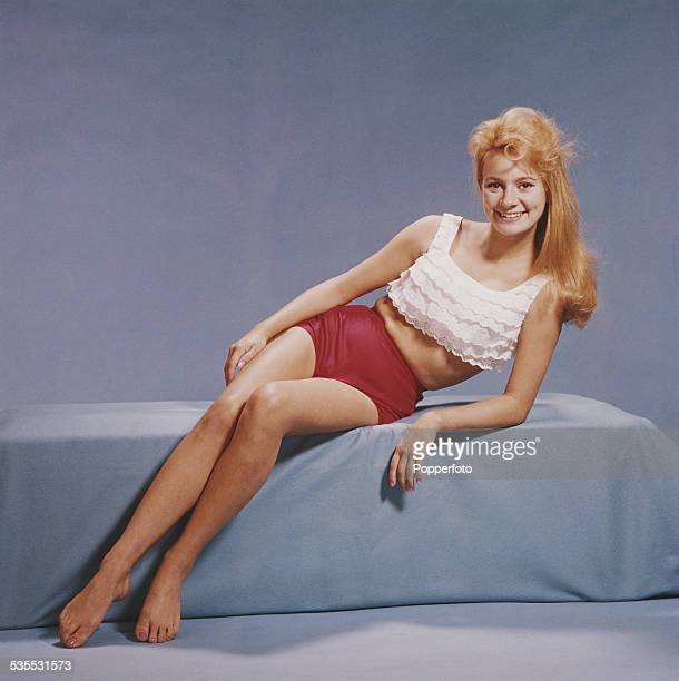 English actress Francesca Annis pictured wearing a white peasant style cropped top and red shorts in 1962.