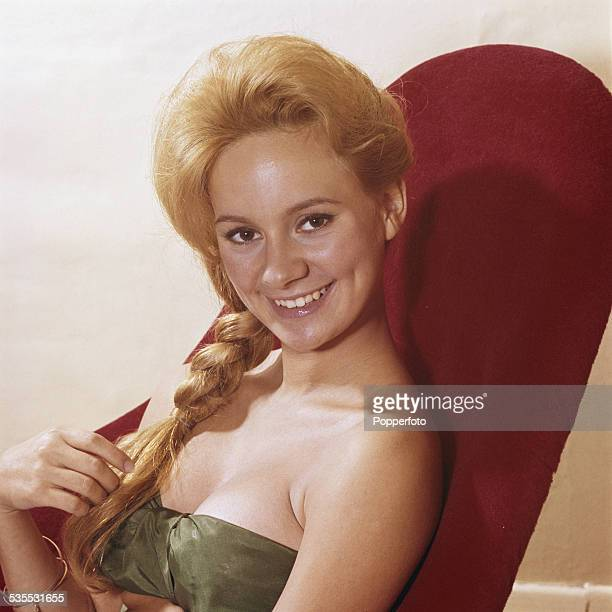 English actress Francesca Annis posed sitting in a red chair in 1962