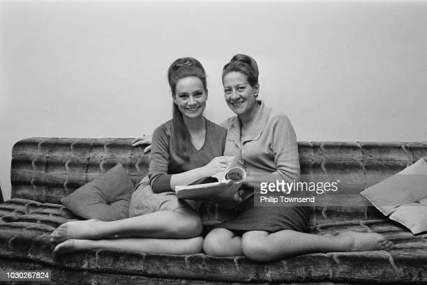 English actress Francesca Annis with her mother Mariquita 'Mara' Purcell sitting on a sofa together UK 17th September 1964
