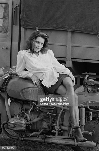 English actress Francesca Gonshaw posed sitting on a motorbike in character as Maria from the television sitcom series 'Allo 'Allo on location in...