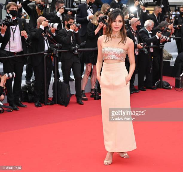 """English actress Gemma Chan arrives for the screening of the film """"Les Intranquilles """" at the 74th annual Cannes Film Festival in Cannes, France on..."""