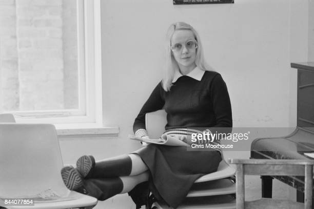 English actress Georgina Hale sits on a stack of chairs UK 13th April 1978