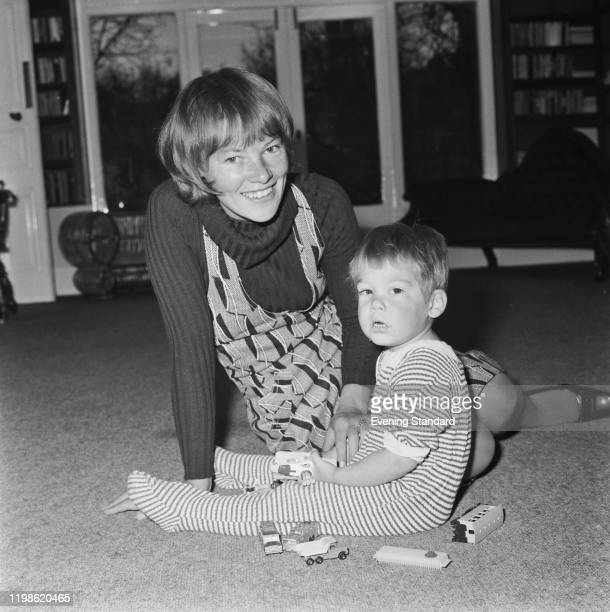 English actress Glenda Jackson seated with her son Dan Hodges on the floor of a living room at home in London on 16th April 1971