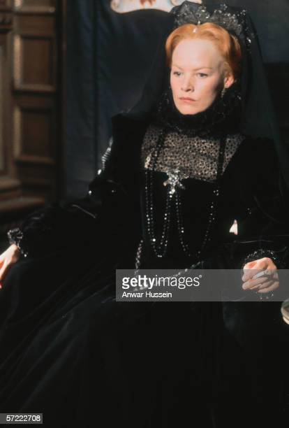 English actress Glenda Jackson stars as Queen Elizabeth I in the television miniseries 'Elizabeth R', 1971. A cigarette adds an incongruous touch to...