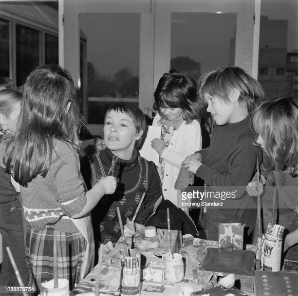 English actress Glenda Jackson with children from Wingfield Primary School in Kidbrooke, London, 12th November 1971. Jackson unveiled a portrait of...
