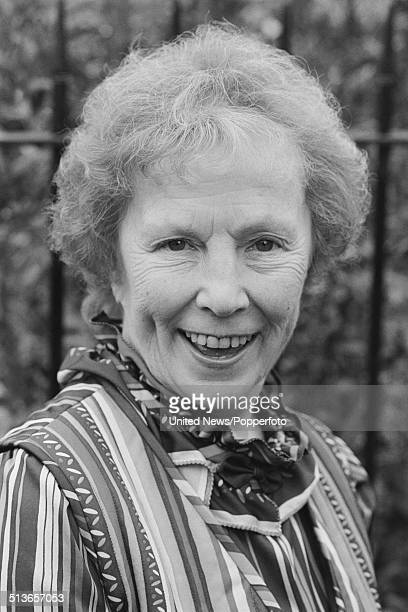 English actress Gretchen Franklin who plays the character Ethel Skinner in the BBC television soap opera EastEnders posed on the Albert Square set in...