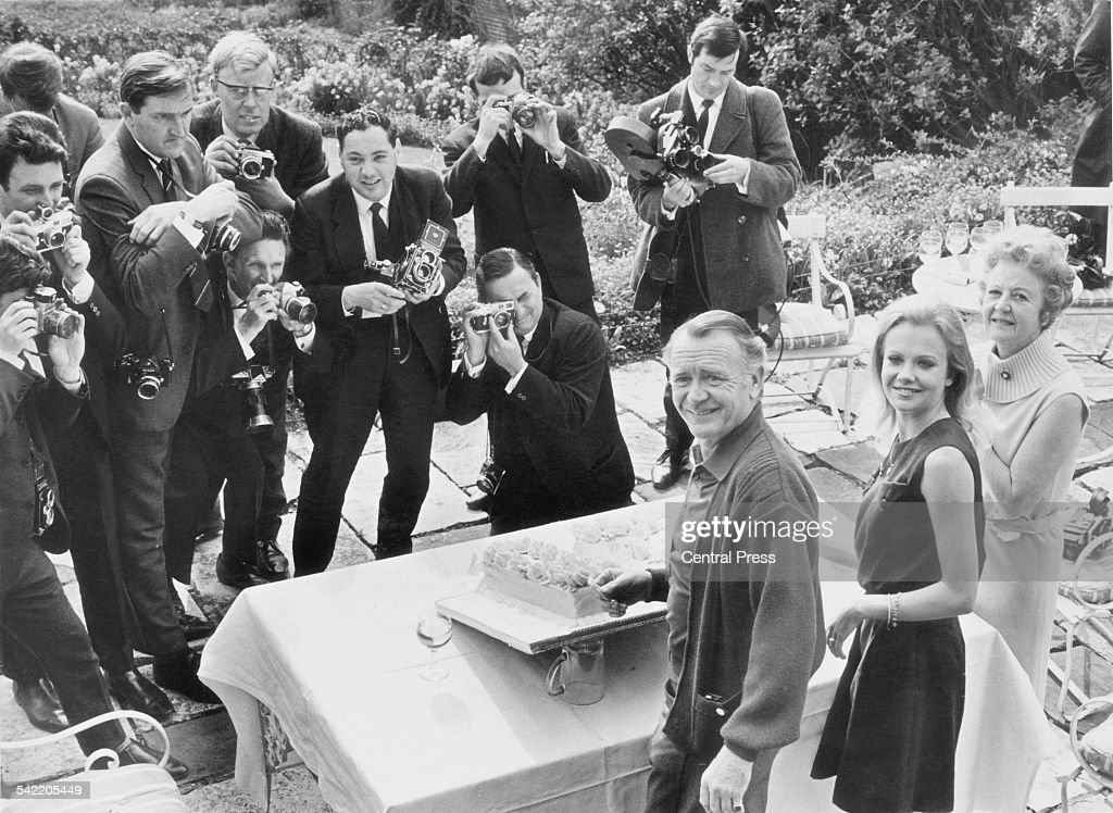 English actress Hayley Mills celebrates her 21st birthday at her parents' home in Richmond, Surrey, 18th April 1967. Here she is pictured with her father, actor John Mills (1908 - 2005) and her mother Mary Hayley Bell (1911 - 2005), and members of the press.