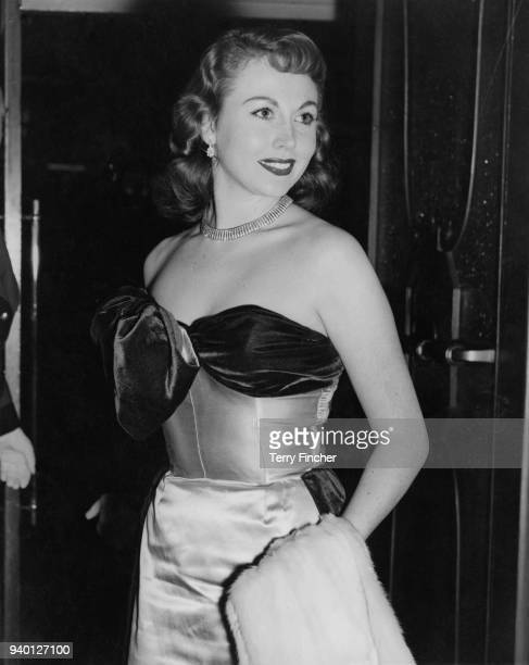 English actress Hazel Court arrives at the Leicester Square Theatre for the premiere of the film 'From Here to Eternity' 12th November 1953 She is...