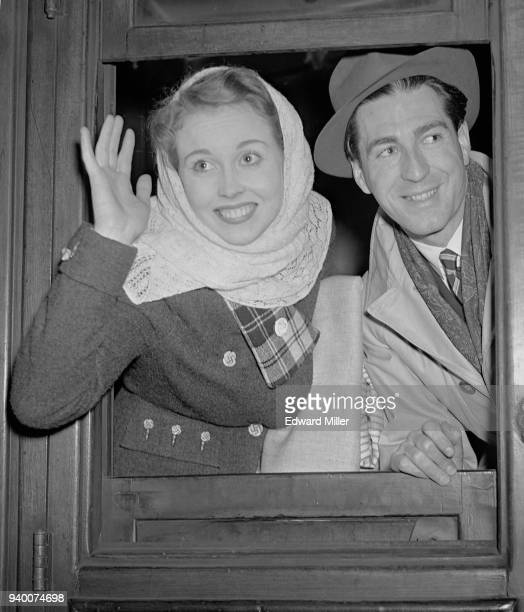 English actress Hazel Court leaves Liverpool Street Station in London with Irish actor Dermot Walsh for a sixweek tour of Germany 29th December 1948...