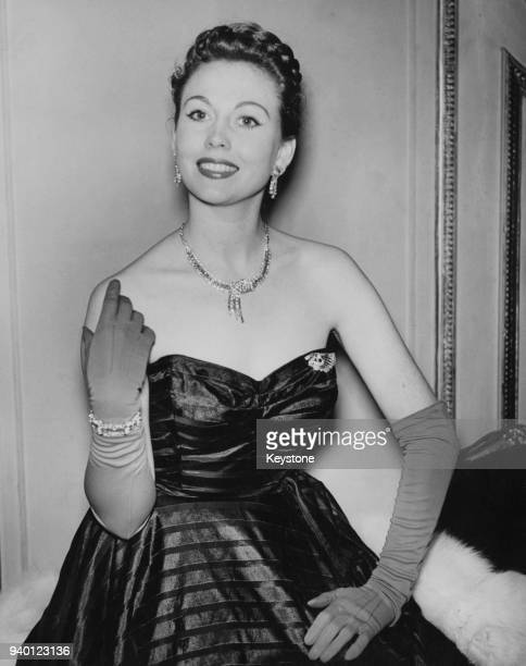 English actress Hazel Court wears a necklace of diamonds set in platinum and a matching bracelet to the premiere of the French ballet 'The Diamond...