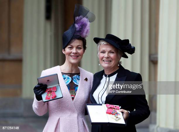 English actress Helen McCrory who was awarded an Officer of the Most Excellent Order of the British Empire for services to drama poses with English...