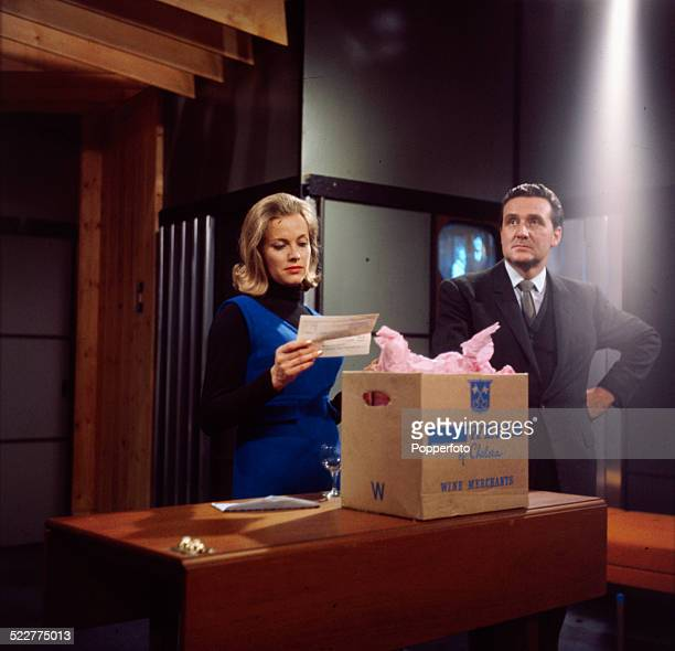 English actress Honor Blackman and English actor Patrick Macnee pictured together in character as Cathy Gale and John Steed in a scene from the...