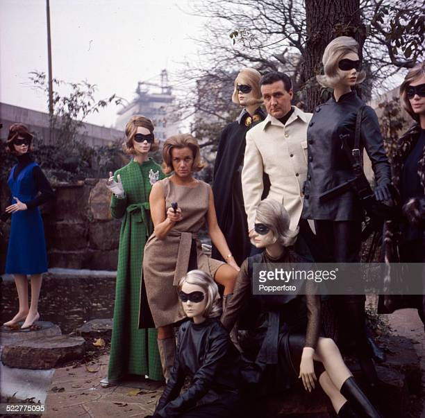 English actress Honor Blackman and English actor Patrick Macnee posed together with various mannequins to promote the television series The Avengers...