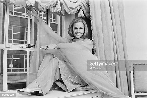 English actress Honor Blackman in the Dior gown she will wear in the play 'Who Killed Santa Claus' London UK 5th February 1970