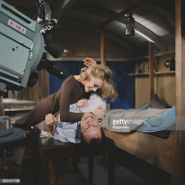 English actress Honor Blackman pictured in character as Cathy Gale fights with a man in a scene from the television drama series The Avengers in 1962
