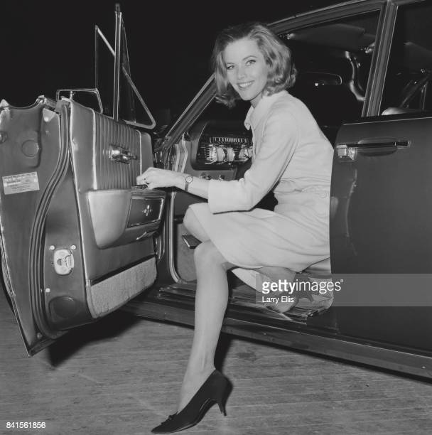 English Actress Honor Blackman smiles while coming out from a car UK 26th March 1964