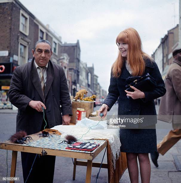 English actress Jane Asher visits a street market stall in London in 1966