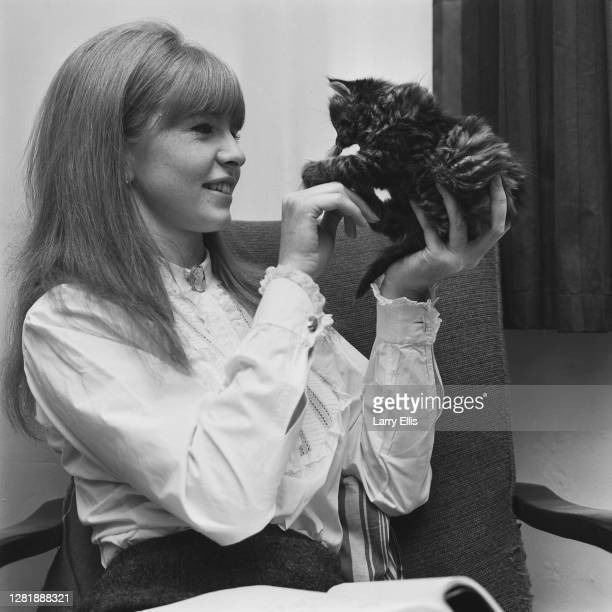 English actress Jane Asher with her kitten Cleo, UK, 12th October 1965. She is starring in a play of the same name at the Bristol Old Vic.