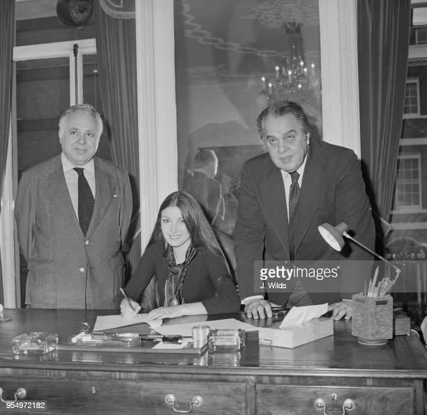 English actress Jane Seymour signs a contract to star in the James Bond film 'Live and Let Die' 11th October 1972 On either side of her are the...