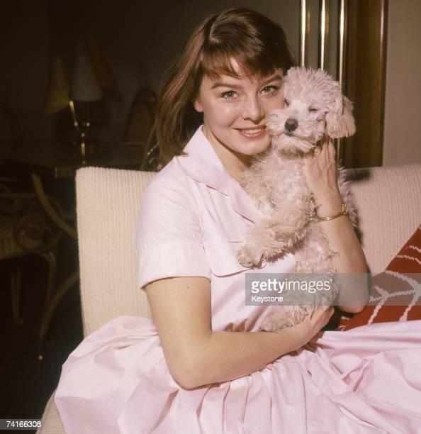 English actress Janet Munro with a pet dog circa 1960