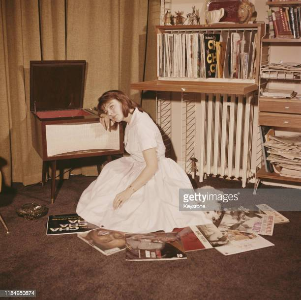 English actress Janet Munro with a pile of records circa 1960