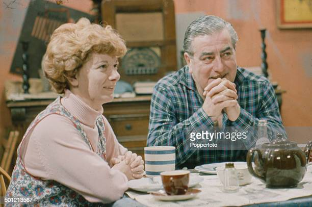 English actress Jean Alexander as 'Hilda Ogden' pictured with actor Bernard Youens as 'Stan Ogden' in a scene from the television soap opera...
