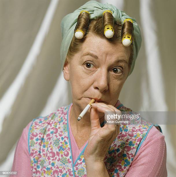 English actress Jean Alexander reprises her role as Hilda Ogden in the television soap opera 'Coronation Street' circa 1990