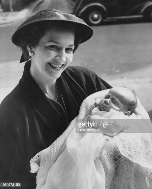 English actress Jean Lodge poses with her baby son Charles George Patrick Shaughnessy after his christening at St James's Spanish Place London 22nd...