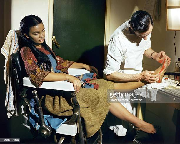 English actress Jean Simmons being made up for her role as the dancing girl Kanchi in 'Black Narcissus' directed by Michael Powell and Emeric...