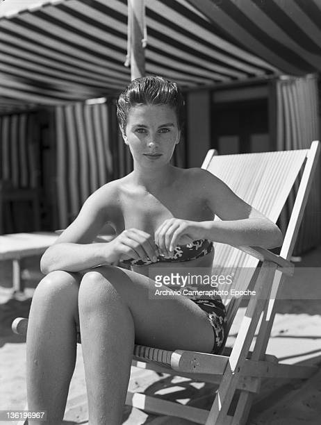English actress Jean Simmons wearing a swimming suit sitting on an sunbed Lido Venice 1950