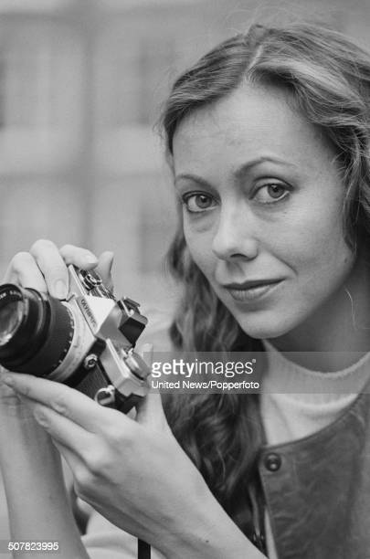 English actress Jenny Agutter posed holding an Olympus camera in London on 9th November 1983.