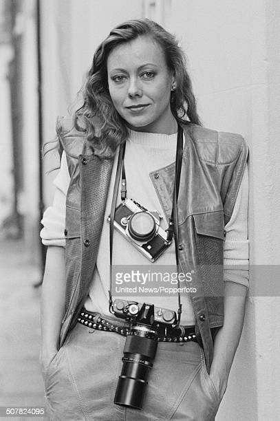 English actress Jenny Agutter posed with two cameras around her neck in London on 9th November 1983