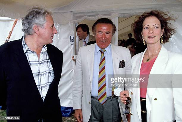 English actress Jenny Seagrove and her fiance film director Michael Winner with journalist Andrew Neil in 1990 ca in London England