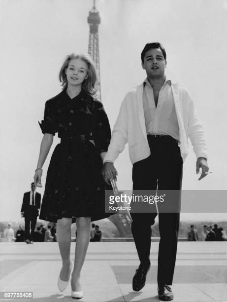 English actress Jill Haworth and American actor Sal Mineo at the Trocadéro Paris 12th May 1961 Behind them across the Seine is the Eiffel Tower The...