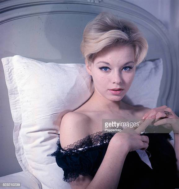 English actress Jill Haworth posed wearing a black lace lined negligee in bed in 1963