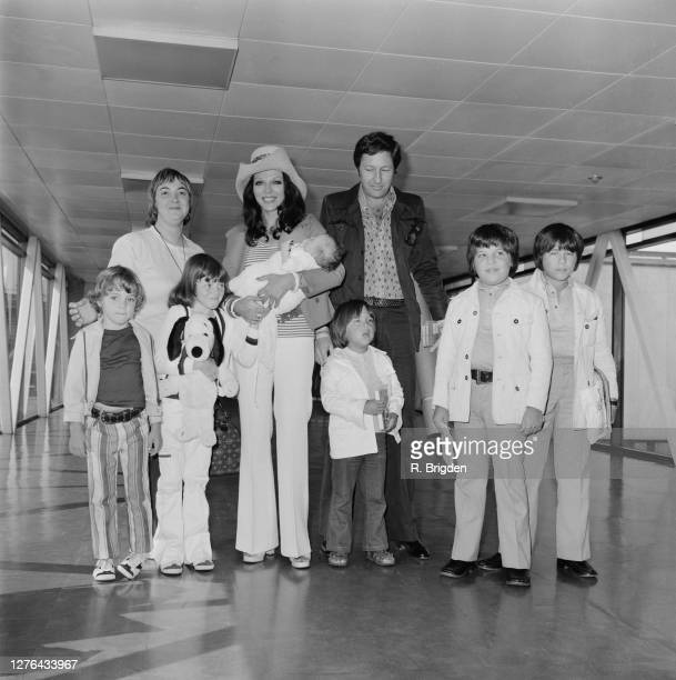 English actress Joan Collins and her husband, businessman Ron Kass with their children at London Airport, UK, 12th August 1972. Pictured are the...