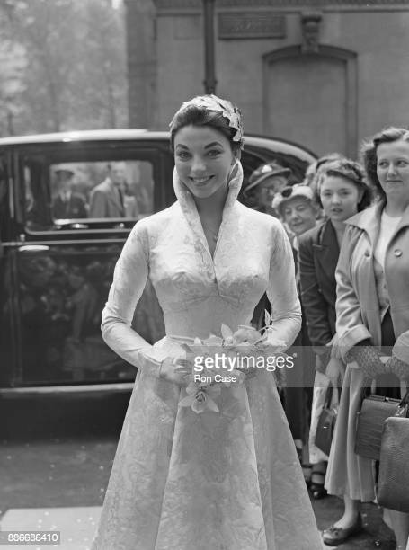 English actress Joan Collins arrives at Caxton Hall in London for her wedding to actor Maxwell Reed 24th May 1952