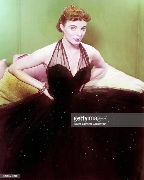 English actress Joan Collins in a black ball gown circa 1955