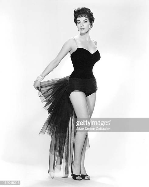 English actress Joan Collins in a showgirl outfit circa 1955