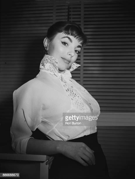 English actress Joan Collins models a lacetrimmed blouse by Sybille and Co in Mayfair London 15th January 1953