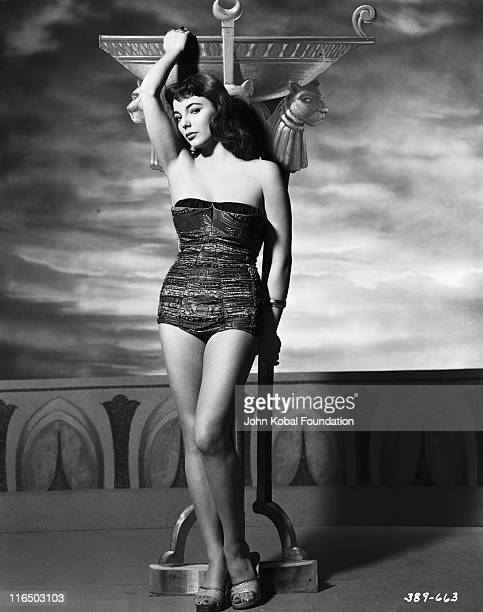 English actress Joan Collins poses against a backdrop reminiscent of ancient Egypt in a publicity still for the Howard Hawks film 'Land of the...