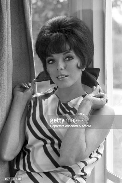English actress Joan Collins posing in her house in London London 2nd July 1964